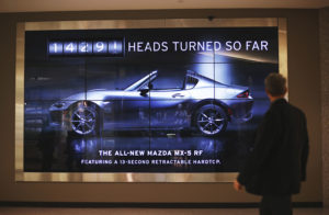 This Mazda Billboard Scans the Crowd to Keep a Tally of How Often the Car Literally Turns Heads